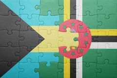 Puzzle with the national flag of dominica and bahamas. Concept royalty free stock photos