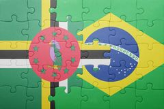 Puzzle with the national flag of dominica and brazil. Concept royalty free stock photography