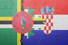 Puzzle with the national flag of dominica and croatia. Concept royalty free stock image