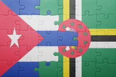 Puzzle with the national flag of dominica and cuba. Concept royalty free stock images