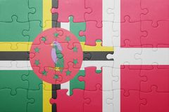 Puzzle with the national flag of dominica and denmark. Concept royalty free stock images