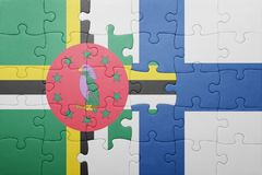 Puzzle with the national flag of dominica and finland. Concept royalty free stock images