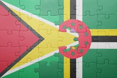 Puzzle with the national flag of dominica and guyana. Concept stock photo