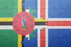 Puzzle with the national flag of dominica and iceland. Concept royalty free stock photography