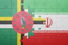 Puzzle with the national flag of dominica and iran. Concept stock image