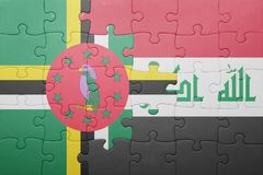 Puzzle with the national flag of dominica and iraq. Concept royalty free stock photography