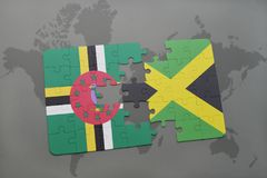 Puzzle with the national flag of dominica and jamaica on a world map background. 3D illustration royalty free stock images