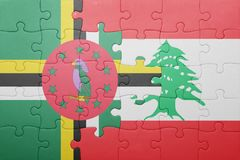 Puzzle with the national flag of dominica and lebanon. Concept royalty free stock photos