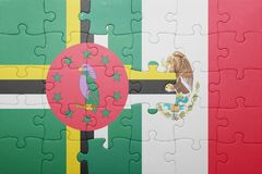 Puzzle with the national flag of dominica and mexico. Concept stock image