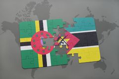 Puzzle with the national flag of dominica and mozambique on a world map. Background. 3D illustration Royalty Free Stock Image