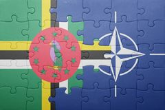 Puzzle with the national flag of dominica and nato Stock Images