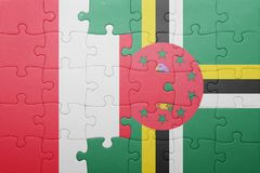 Puzzle with the national flag of dominica and peru. Concept stock photos