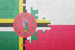 Puzzle with the national flag of dominica and poland. Concept royalty free stock photos