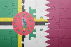 Puzzle with the national flag of dominica and qatar. Concept stock photos