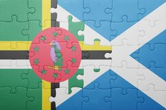 Puzzle with the national flag of dominica and scotland. Concept stock image