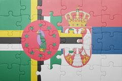 Puzzle with the national flag of dominica and serbia . concept. Puzzle with national flag of dominica and serbia . concept royalty free stock photo