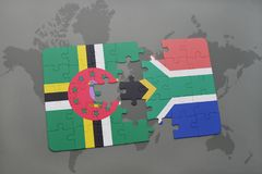 puzzle with the national flag of dominica and south africa on a world map Royalty Free Stock Images