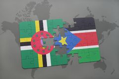 puzzle with the national flag of dominica and south sudan on a world map Stock Images