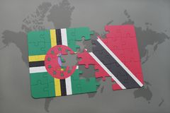 Puzzle with the national flag of dominica and trinidad and tobago on a world map background. 3D illustration royalty free stock image