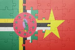Puzzle with the national flag of dominica and vietnam. Concept stock image