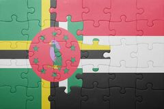 Puzzle with the national flag of dominica and yemen. Concept stock photo