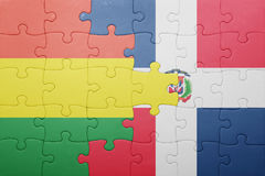 Puzzle with the national flag of dominican republic and bolivia. Concept Stock Photo