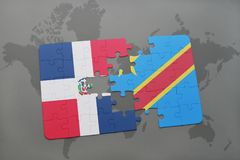 Puzzle with the national flag of dominican republic and democratic republic of the congo on a world map Royalty Free Stock Photo