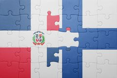 Puzzle with the national flag of dominican republic and finland Stock Photo