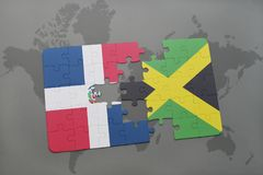 Puzzle with the national flag of dominican republic and jamaica on a world map background. 3D illustration royalty free stock photo