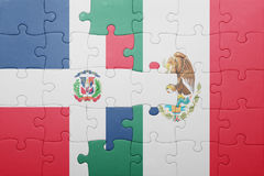 Puzzle with the national flag of dominican republic and mexico. Concept stock images