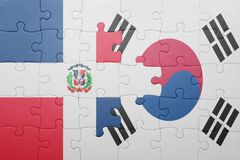 Puzzle with the national flag of dominican republic and south korea Stock Photo
