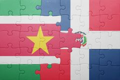 Puzzle with the national flag of dominican republic and suriname. Concept Stock Photo