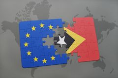 Puzzle with the national flag of east timor and european union on a world map Stock Photos