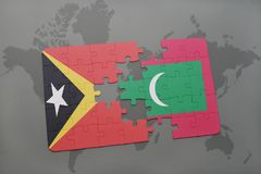 Puzzle with the national flag of east timor and maldives on a world map background. 3D illustration Royalty Free Stock Photography