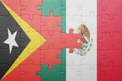 Puzzle with the national flag of east timor and mexico. Concept royalty free stock image