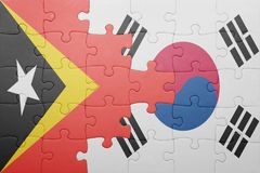 Puzzle with the national flag of east timor and south korea. Concept stock photography