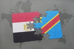 Puzzle with the national flag of egypt and democratic republic of the congo on a world map. Royalty Free Stock Images