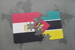 Puzzle with the national flag of egypt and mozambique on a world map. Puzzle with the national flag of egypt and mozambique on a world map background. 3D Royalty Free Stock Photography
