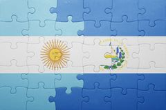 Puzzle with the national flag of el salvador and argentina Royalty Free Stock Image