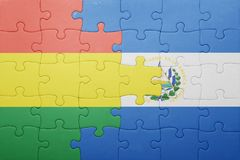 Puzzle with the national flag of el salvador and bolivia Stock Image