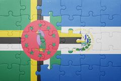 Puzzle with the national flag of el salvador and dominica. Concept stock photography