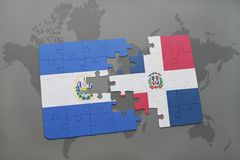 puzzle with the national flag of el salvador and dominican republic on a world map background. Stock Photo