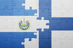 Puzzle with the national flag of el salvador and finland. Concept Stock Images