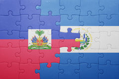 Puzzle with the national flag of el salvador and haiti. Concept Royalty Free Stock Photography