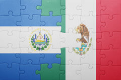 Puzzle with the national flag of el salvador and mexico. Concept Royalty Free Stock Photos