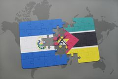 Puzzle with the national flag of el salvador and mozambique on a world map Royalty Free Stock Photography