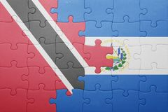 Puzzle with the national flag of el salvador and trinidad and tobago Royalty Free Stock Photo