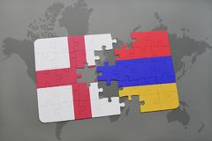 Puzzle with the national flag of england and armenia on a world map background. Royalty Free Stock Photos