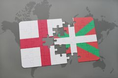 Puzzle with the national flag of england and basque country on a world map background. 3D illustration Royalty Free Stock Photos