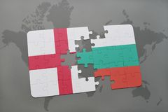 Puzzle with the national flag of england and bulgaria on a world map background. Stock Images